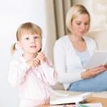 Little girl on phone in living room — Stock Photo