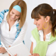 Student at home - two young woman study together — Stock Photo #4690921