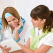 Student at home - two young woman study together — ストック写真
