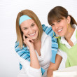 Student at home - two young woman study together — Stock Photo #4690938