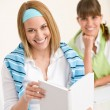 Student at home - two young woman study together — Stockfoto