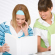 Stock Photo: Student at home - two young woman study together