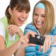 Two young cheerful woman with camera — Foto Stock