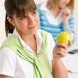 Student at home - happy woman with apple — Стоковое фото #4690973