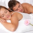 Young couple lying in bed — Stock Photo