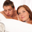 Young couple lying in white bed — Stock Photo