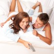 Young man and woman lying down in lounge — Stok fotoğraf