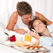 Young smiling couple having luxury breakfast — Stock Photo #4691179