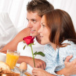 Young couple having luxury hotel breakfast - 图库照片