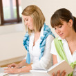 Student at home - two woman with book and laptop — Stock Photo