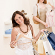 Fashion shopping - Two happy young woman choose clothes — Stockfoto #4691284