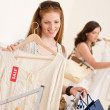 Fashion shopping - Two happy young woman choose clothes — Foto de stock #4691309