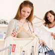 Fashion shopping -  Two happy young woman choose clothes — Stock Photo