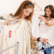 Fashion shopping - Two happy young woman choose clothes — 图库照片