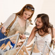 Fashion shopping - Two Happy woman choose sale clothes - Foto Stock
