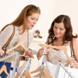 Fashion shopping - Two Happy woman choose sale clothes — Foto de Stock