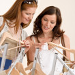 Fashion shopping -  Two happy young woman choose clothes — Foto Stock