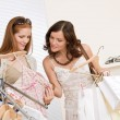 Fashion shopping - Two happy young woman choose clothes — Foto Stock #4691326