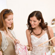 Fashion shopping - Two Happy woman choose sale clothes — Stockfoto