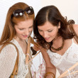 Fashion shopping - Two Happy woman choose sale clothes — Foto Stock