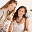 Stock fotografie: Fashion shopping - Two Happy woman choose sale clothes