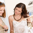 Fashion shopping -  Two happy young woman choose clothes — Стоковая фотография