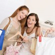 Fashion shopping - Two happy young woman choose clothes — Stock Photo #4691340