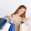 Fashion shopping - Happy woman with bag and dress — Stock Photo