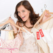 Fashion shopping - Happy woman choose sale clothes - Stock Photo