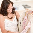 Fashion shopping - Happy woman choose sale clothes — Stock Photo #4691362