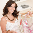 Stock Photo: Fashion shopping - Happy woman choose sale clothes
