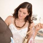 Fashion shopping - Happy woman choose sale clothes — Stock Photo