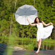 Stock Photo: Happy romantic woman with parasol in sunlight