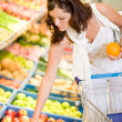 Grocery store - smiling woman shopping choose fruit — Foto Stock