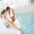 Swimming pool - young happy couple relax — Stock Photo #4691761