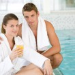 Young sportive couple relax at swimming pool — Stock Photo