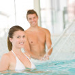 Young sportive couple have fun in pool, focus on woman — Stock Photo #4691807