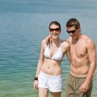 Happy couple in swimwear at sea enjoy sun — Stock Photo #4691945