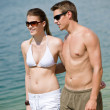 Happy couple in swimwear walk in lake — Stock Photo #4691947