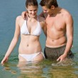 Couple in swimwear enjoy water and sun in summer — Stock Photo