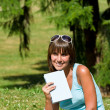 Happy young woman with book in park — Foto Stock
