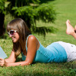 Relax in park - woman with book on sunny day — Stock Photo #4692122