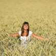 Stock Photo: Happy young woman in corn field enjoy sunset