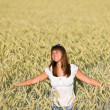 Happy young woman in corn field enjoy sunset — Stock Photo