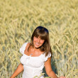 Happy woman in corn field enjoy sunset — Stock Photo #4692144