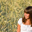 Young woman in corn field enjoy sunset — Stock Photo