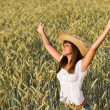 Happy woman with straw hat enjoy sun in field — Stock Photo