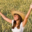 Happy woman enjoy sun in corn field — Stock Photo