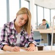 High school - Thoughtful female student in classroom — Stock Photo