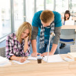Two students at high school writing notes - Stock Photo